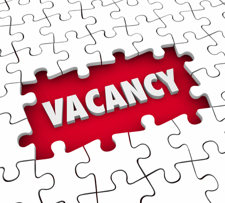 vacant: Vacancy word in 3d letters in a puzzle hole missing pieces to illustrate a need to fill an open job position or find a tenant for renting an apartment