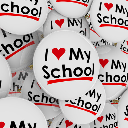 spirit: I Love My School with heart symbol on buttons or pins to illustrate pride in ones high school, college or university Stock Photo