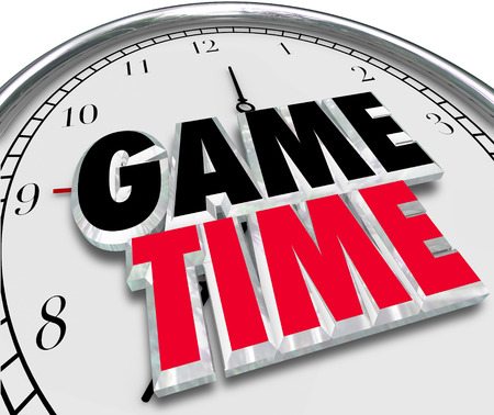 game time: Game Time words in 3d letters on a clock face to illustrate playing, enjoyment and having fun at an event with family and friends Stock Photo