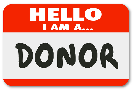donor: Donor word written on a red name tag hello sticker to be worn by a contributor, benefactor or supporter Stock Photo