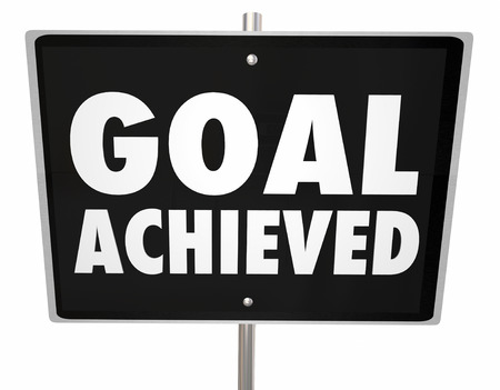attaining: Goal Achieved words on a sign to illustrate a mission accomplished or successful project