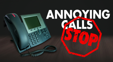 solicit: Stop Annoying Calls words on a telephone to illustrate wanting to end frustrating sales or telemarketing phone solicitation