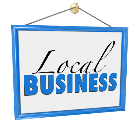 company ownership: Local Business words on a hanging sign or advertisement for a small independent entrepreneur owned company Stock Photo