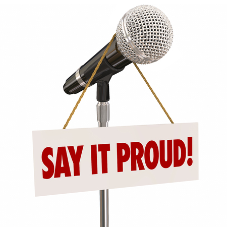 gratifying: Say it Proud words on a sign around a microphone to illustrate pride in public speaking and making a statement at a forum before an audience Stock Photo