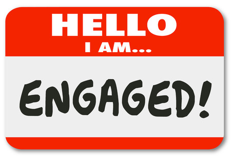 proposed: Hello I Am Engaged words on a nametag sticker to illustrate your involvement, interest or paying attention or your status as a fiancee for marriage following a wedding proposal