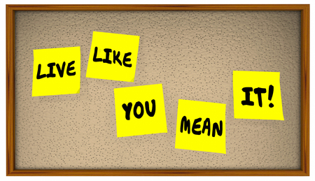 mean: Live Like You Mean It Quote Saying Sticky Notes Board 4K Stock Photo