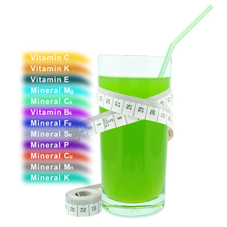 kiwi juice with meter, vitamins and minerals on a white background  photo