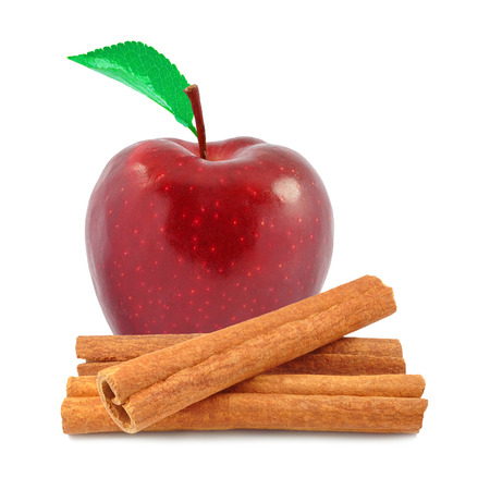 red apple and cinnamon on white background