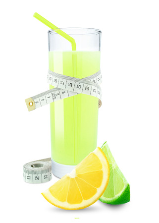 lemon juice: lemon-lime juice in a glass and meter on white background  Stock Photo