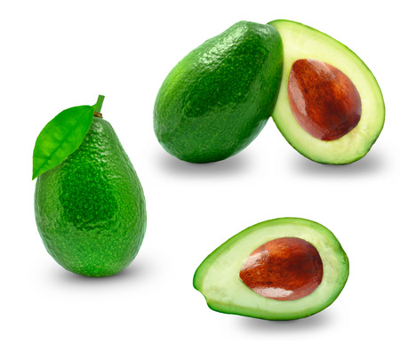 ripe avocado and half on white background photo