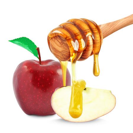 manzana roja: manzana y miel del goteo aislado en blanco