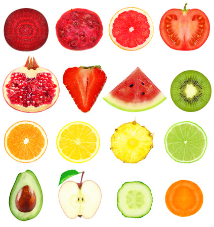 tropical food: fresh slices of fruits and vegetables on a white background