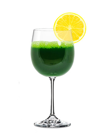 toxins: wheatgrass juice in a glass and lemon isolated Stock Photo