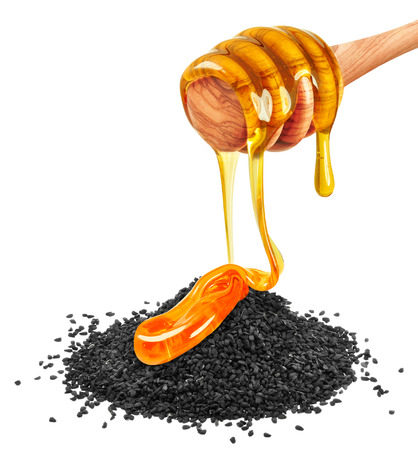 Black cumin with honey isolated on a white background