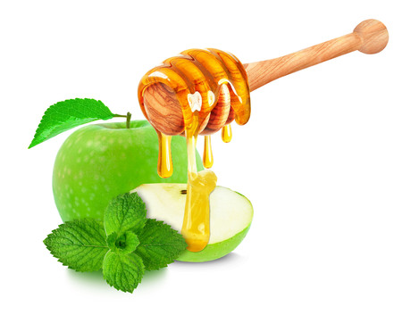 green apple and dripping honey isolated on white
