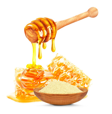 royal jelly and dripping honey isolated on a white background