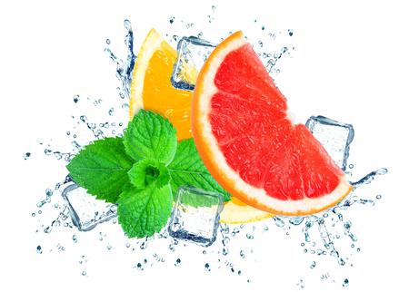 grapefruit and orange splashing water and ice cubes isolated on the white