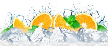 orange water splash and ice cubes isolated on the white
