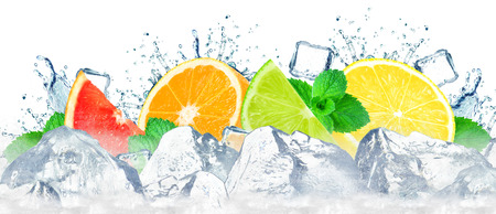 citruses water splash and ice cubes isolated on the white