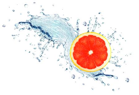 grapefruit splashing water isolated on white