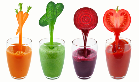 vegetable juices in a dripping glass isolated on white Stock fotó