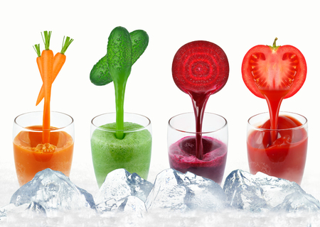 vegetable juices in a glass and ice isolated on white