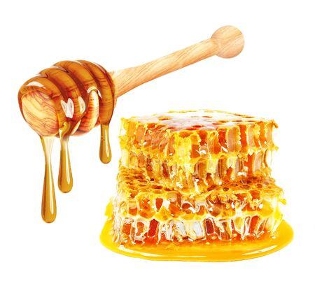 miel dégoulinant et nid d'abeille isolé sur fond blanc Banque d'images