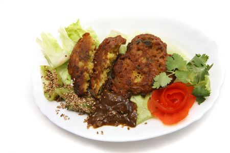 roasted sesame: onion bhagees, tamarind sauce and green tomatoes with roasted sesame seeds from indian restoran Stock Photo