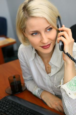 congenial: Young businesswoman talk on the phone in the office Stock Photo