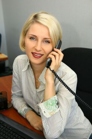 Young businesswoman talk on the phone in the office Stock Photo - 3412958
