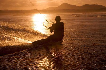 Kite surfer, ocean and sunset