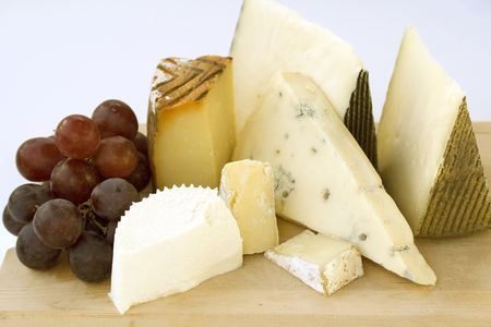 cheese platter: An assortment of cheeses on a cheese-board