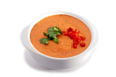 gaspacho: White bowl of gaspacho soup on white background