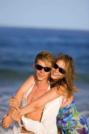 happy smiling young couple  on the beach photo