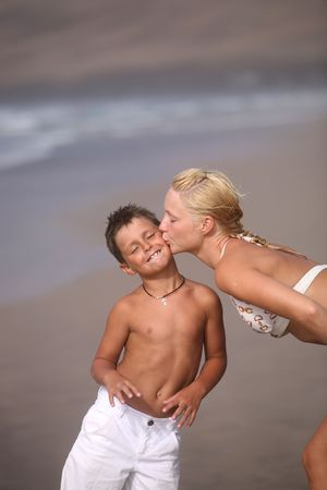 mom and son: Happy Mother and son on the beach Stock Photo