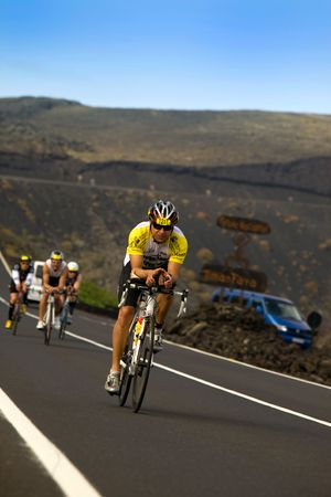 ironman: LANZAROTE, SPAIN - MAY 22: Group of cyclists in ironman Triathlon 2010 Event May 22 in Lanzarote Spain.  Editorial