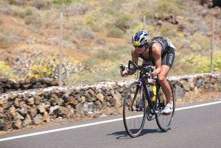 lanzarote: LANZAROTE, SPAIN - MAY 22: Group of cyclists in ironman Triathlon 2010 Event May 22 in Lanzarote Spain.  Editorial