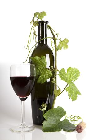 Glass red wine and bottle with grape�s leafs Stock Photo