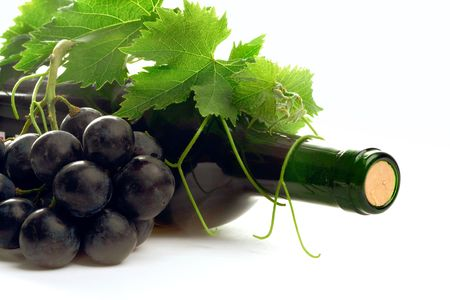 bottle red wine with grape and leafs  Stock Photo