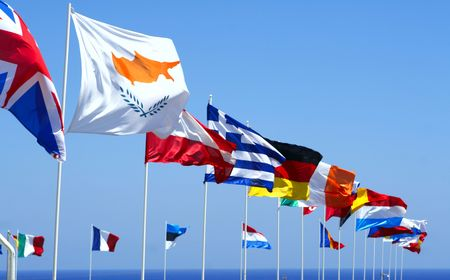 Flags of the EU against blue sky