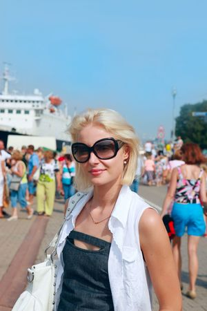 latvia girls: Young woman in sunglasses on  sea port