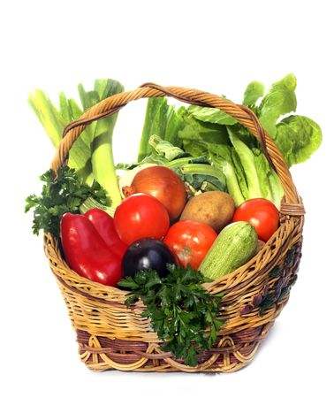 basket with vegetables isolated on white  photo