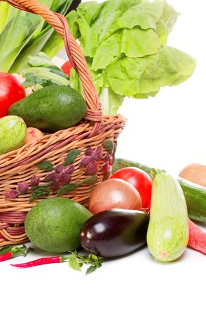 spliced: basket with vegetables isolated on white