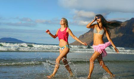 two beautiful women on the beach photo