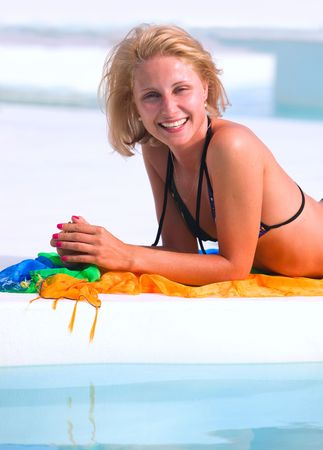 Young woman in the pool  photo