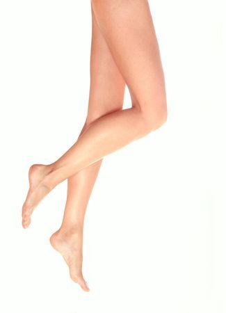 Beautiful female legs on white background.  Stock Photo