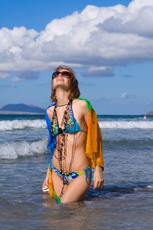 young blond woman with kerchief on  the beach photo