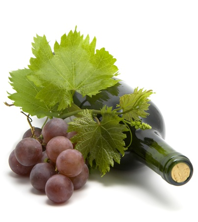 bottle of wine with grape wine leafs and vine photo