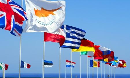 Flags of the EU against blue sky