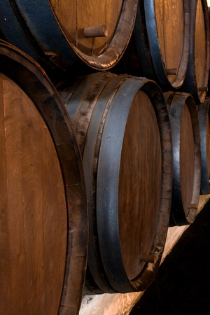 stacked wine barrels in the wine cellar  Stock Photo - 9137983